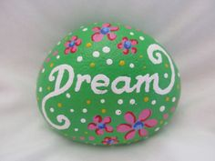 Hand painted rock Dream  Acrylic paints on a river rock, gloss finish.  Size : 2.5 x 2 x 1 inch  Thank you for visiting my shop