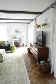 Young House Love - Love the color in this living room and the hanging shelf above the TV