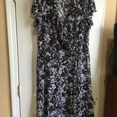 Dress Black and white rose print. Very sheer and flowing. Ruffles around neck and front wit tie belt, cap sleeves wit buttons. Pics don't do it justice. ABS Woman Dresses Midi