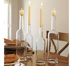 Pottery Barn ideas - Gather a few glass bottles and stuff them with candles.