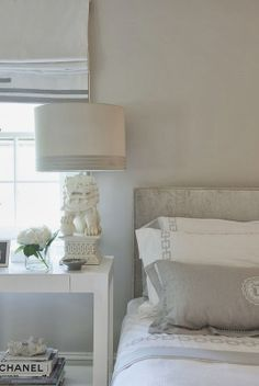 Bedroom - Soft whites  greys.  White Foo Dog lamp is fabulous!  Style Profile: Laura Tutun