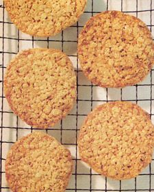 Oatmeal-Lace Cookies - Martha Stewart Recipes: Crisp and chewy at the same time, simple to make, and they keep well in an airtight container. Hands down my favorite cookie! Try serving with peach ice cream as an ice cream sandwich- HEAVEN. Oatmeal Lace Cookies, Oatmeal Cookie Recipes, Raisin Cookies, Lace Cookies Recipe, Lemon Cookies, Yummy Cookies, Scones, Delicious Desserts, Dessert Recipes