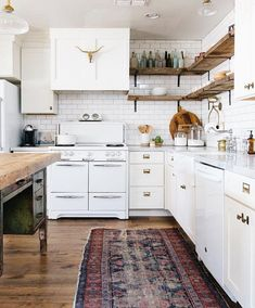 Painted Kitchen Cabinet Ideas - A Vintage Market Founder's Stunning Eclectic Home - Inspired By This Decorating Above Kitchen Cabinets, Above Cabinets, Painting Kitchen Cabinets, Kitchen Paint, Kitchen Decor, Kitchen Ideas, Open Cabinets, Kitchen Layout, Kitchen Living