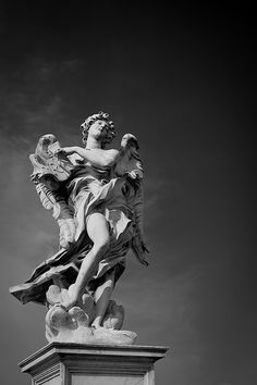 "(caption under photo) Angel statue from the Ponte Sant'Angelo in Rome. There are ten angel statues on the bridge, each with their own significant apparatus to display. This one is the ""Angel with the Superscription."""