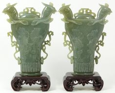 Pair of Antique Chinese hand carved celadon jade Phoenix covered vase vessels.