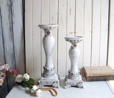 Repurposed ceramic candleholders finished in a shade of light gray with gold and metal roses, perfect for farmhouse cottage decor! Candleholders, Candlestick Holders, Candlesticks, French Cottage Decor, Shabby Chic Cottage, Estilo Soho, Metal Roses, Wrought Iron Fences, Garden Deco