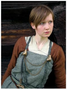 deviantART: More Like Shieldmaiden by *VendelRus.  Note that the straps are tablet-woven bands, and they appear not to be sewn down in the front but only fastened by the brooches.