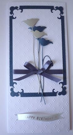 A DL prim poppy die card. I just love this die. Interesting use of corner punch for layered effect.