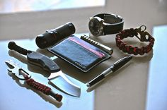 Atwood tool with a lanyard and Damascus bead Boker Rhino Coach wallet/money clip Brunton Lighter (Firestorm) Kerry pencel Prometheus Beta Q...