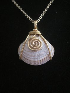 Wire wrapped shell pendant. | jewelry