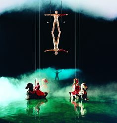 """An aerial duet sharing a single trapeze invokes the splendor of harmony and trust.    ( """"O"""" by Cirque du Soleil ) http://cirk.me/1w2bRvO"""