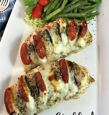 Hassleback chicken stuffed with mozzarella, tomato and basil is a new way to enjoy chicken for dinner tonight!