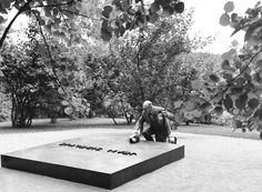Igor Stravinskij lays flowers on Jean Sibelius' grave at Ainola, home of the Finnish composer, Finland, on September 10. 1961.