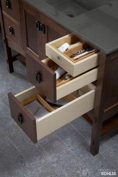 Amazing bathroom storage featuring Kohler Marabou