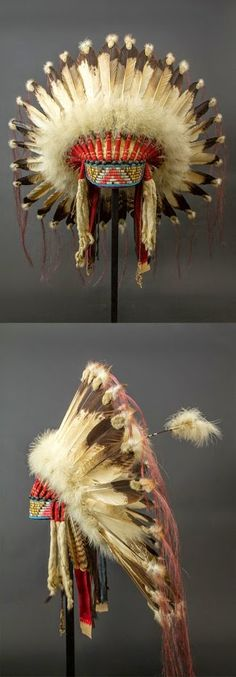 An absolutely stunning Warrior headress, Sioux style. Made of Eagle feathers, horsehair, quills and beads. Circa 1920-1930.