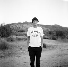 Justin in the 'Badland' Tee  Available in Washed White and Washed Black