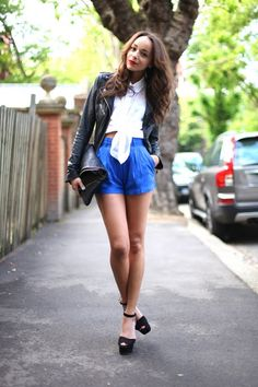Love high waisted shorts with a peek a boo belly, bow tied blouse.