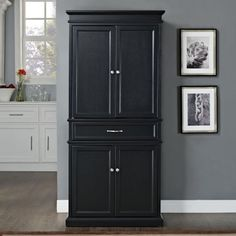 Crosley Parsons Pantry in Black Crosley,http://www.amazon.com/dp/B00FRE2FXY/ref=cm_sw_r_pi_dp_8OvDtb0N6WWW46TC