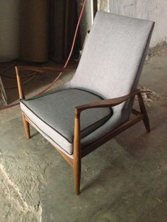 chair in fabric and walnut wood, $1,700