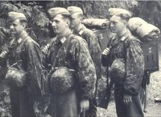 Here is one of the most unusual pictures I have ever seen. The four guys in the picture are Luftwaffe, but they are wearing SS camouflage. More than likely, they were in the Hermann Goering division, which wore SS camouflage a lot.