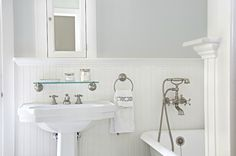 Suzie: Titan and Co - Lovely bathroom with silvery gray walls paint color, chair rail & ..Lovely bathroom with silvery gray walls paint color, chair rail & beadboard backsplash, glossy white pedestal sink, Restoration Hardware Vintage Glass Shelf, white framed inset medicine cabinet, vintage clawfoot tub and brushed nickel faucet & shower kit..
