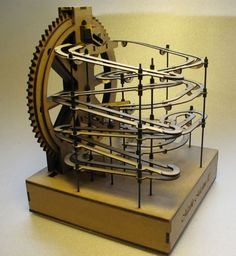 Marble Machine 2 is motorized and features dual tracks with a track switch and a ball accumulator The lifting mechanism is the wheel type Everything