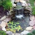 Landscaping, Awesome Small Backyard Ponds Ideas Surrounded By Stone Pile Edge And Tiny Waterfall Also Plenty Water Lilies: Magnificent Backyard Ponds To Beautify Your Home