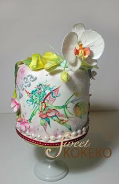 Fairy and Orchid Cake! Is a painted cake full of flowers