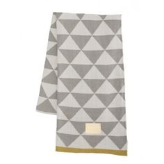ferm LIVING used their graphic prints to make this gorgeous jacquard knitted blanket. The blanket is made of cotton and the jacquard knit inverts the colou