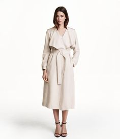 Trenchcoat $79.99 | H&M US Art.No. 37-0342 Trenchcoat in woven fabric with a heavy drape. Small stand-up collar, shoulder tabs, and side-seam pockets. Vent at back, removable tie belt, and no buttons. Unlined.