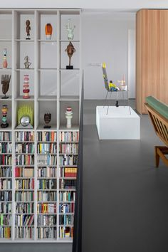 Double-height shelving and custom glass vitrines create ample storage space in this Amsterdam apartment, which was designed by local studio i29 to accommodate the owner's vast collection of art and books. Mid-century Interior, Apartment Interior, Apartment Design, Interior Decorating, Amsterdam Apartment, Amsterdam Houses, Amsterdam Netherlands, Contemporary Interior Design, Best Interior Design