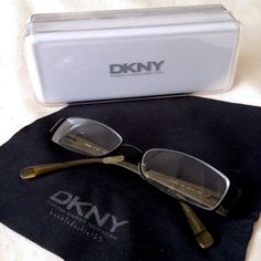 DKNY eyeglasses & case Authentic Donna Karan New York designer glasses • Classic rectangular frames in black, with tan accents on inside temples. Lightweight.  Excellent condition; minimal signs of wear. Original prescription lenses easily replaced • Velvet-lined case and soft cloth included. DKNY Accessories Glasses