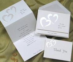 white folded heart wedding invitation