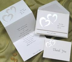 These invitations are great. A mix of two of my wedding themes: hearts and the color silver