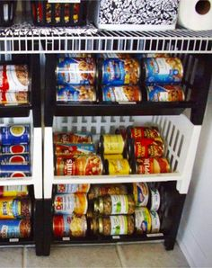 Smart way to organize canned goods in a small pantry using cheap dollar store stacking baskets / bins.