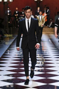 Mimetic of the Jazz Age's classic opulence, Dolce & Gabbana have favoured the deep amber golds, rich oxblood, and the perennial black suit in their 2017 summer collection. Another influence so clearly coming through from the design house's rationale is music. In all its iterations, music forms a tether to memory in its fluid and
