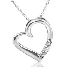 This classic heart pendant features 3 round brilliant cut natural diamonds. An white gold clasp lock chain is included. All diamonds are set in solid white gold. White Gold Diamonds, Colored Diamonds, Natural Diamonds, Diamond Color Grade, Heart Shaped Diamond, Heart Pendant Necklace, Gold Pendant, Diamond Cuts, Jewelry