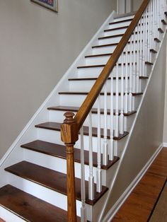 Transform builder-grade carpeted stairs to stained wood treads & white painted risers for around 35 bucks.