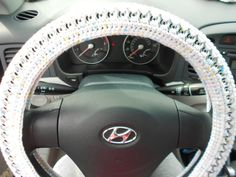 Hey, I found this really awesome Etsy listing at http://www.etsy.com/listing/127439853/crochet-pop-tab-steering-wheel-cover