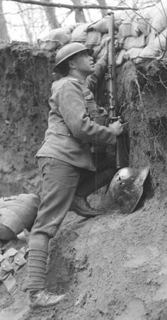 In the trenches, WWI. (Side note: looks like a captured German helmet on the bottom right corner)