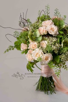 Summer and winter theme Bridal Bouquet. Pale peach and lime green fresh and light atmosphere wedding Bouquet. Dainty elements: peach  spray roses, heleborus, trachelium, new leaves, adianthum fern, thlaspi, twigs. www.joannamarriottflowers.co.uk