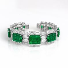 Emerald bangle by David Morris featuring 42.34ct emerald-cut Colombian emeralds and white diamonds set in white gold