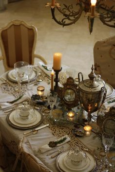 Holiday table ~ supposedly, the French place the fork face down on the tablecloth so that the tines will not snag the ruffled lace sleeves of the guests.