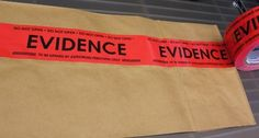 Set design: Evidence Box Sealing Tape by Crime Scene, http://www.amazon.com/dp/B004ILX86K/ref=cm_sw_r_pi_dp_-4ITrb0K9FSQ1