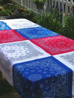 could use just red and white for red gingham barbecue  Fourth of July table cloth, then use some separate bandanas as napkins - love this idea!!