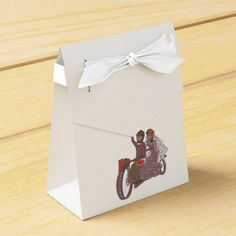 Couple with motorcycle. Favor boxes to match other wedding stationary and accessories. Add text option.
