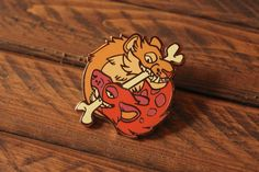 Bite Like a Girl measures roughly 1.75 and has one post on the back for fastening. It's plated with rose gold.  All enamel pins come with butterfly clasps. Locking backings are available in the Lydiarts and Craft shop.   Please be aware that Lydiarts and Crafts is dedicated to reducing waste, t