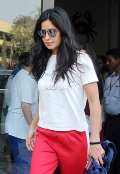 Katrina Kaif doning a casual look in white t-shirt, red track pants and glares