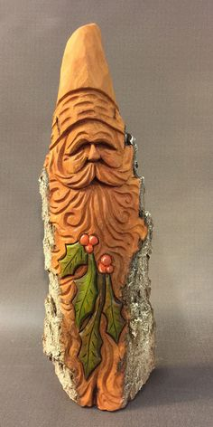 A personal favorite from my Etsy shop https://www.etsy.com/listing/507756015/hand-carved-original-santa-bust-w-holly