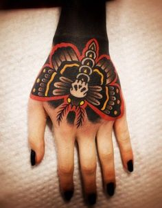 Obsessed with this American traditional hand tattoo. #inked #inkedmag #tattoo…
